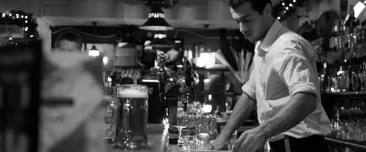 Bartender cleaning up